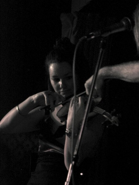 Rachel of 6 Day Riot with Tim, performing Perineum Millennium